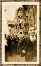 Members of the Saint Rocco Society of Potenza dutifully walk in procession carrying their beloved Saint Rocco
