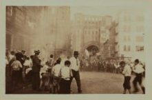 Onlookers watch as the procession nears over 100 years ago