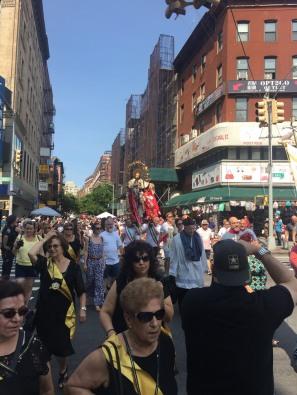 Devotees walk along Mulberry Street