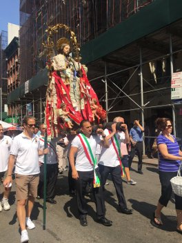 Devotees and members of the Saint Rocco Society of Potenza carry their Patron through the streets of Little Italy in Manhattan