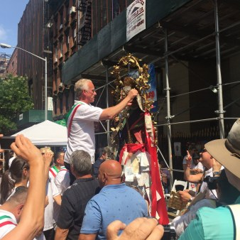 Stephen LaRocca adjusting the statue before the procession