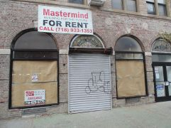 Little Italy in the Bronx, New York. Notice the name beautifully set in stained glass over the doorway.