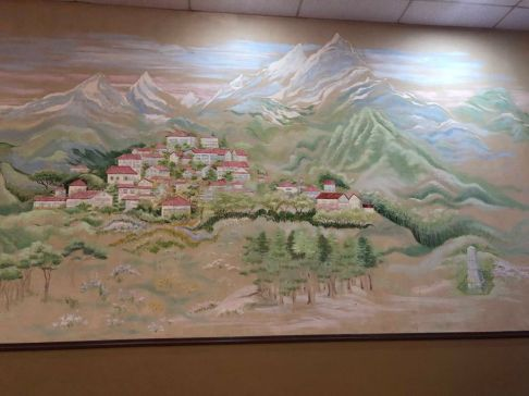 The mural in the society hall depicting the mountaintop where La Madonna promised snow in Rome.