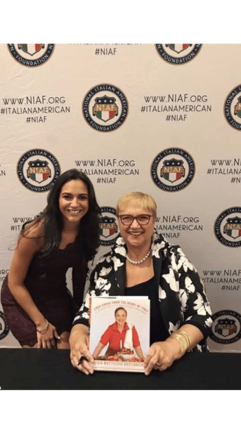 Diane Marie Pisera gets her signed copy of Lidia's cookbook