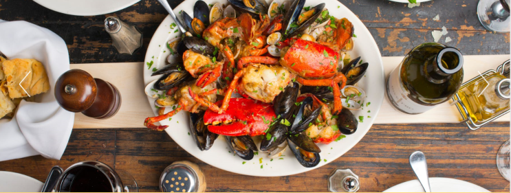 Lobster Patrizia's Clams, Mussels, Roasted Garlic, White Wine Sauce
