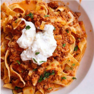 Pappardelle Alla Bolognese meat ragù topped with mascarpone